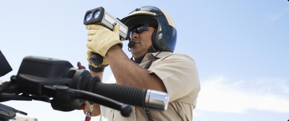 policeman holding a speed gun
